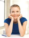 Happy teenage girl with pen and paper Royalty Free Stock Photography