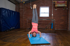 Happy teenage girl performing headstand Royalty Free Stock Photo