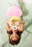 Happy teenage girl photographing with with phone Royalty Free Stock Photos