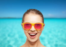 Happy teenage girl in pink sunglasses Royalty Free Stock Photography