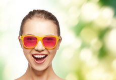Happy teenage girl in pink sunglasses Stock Image