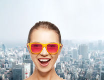 Happy teenage girl in pink sunglasses Stock Images