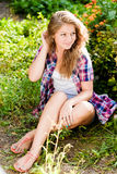 Happy teenage girl portrait in summer garden Stock Image