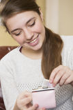 Happy Teenage Girl Putting Money Into Purse Stock Images
