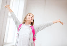 Happy teenage girl with raised hands Royalty Free Stock Image