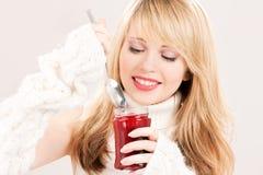 Happy teenage girl with raspberry jam Stock Photography