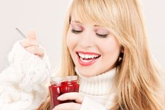 Happy teenage girl with raspberry jam Royalty Free Stock Image