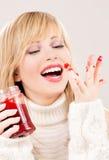 Happy teenage girl with raspberry jam Stock Photos