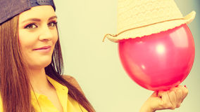 Happy teenage girl with red balloon. Stock Photography