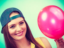Happy teenage girl with red balloon. Royalty Free Stock Images