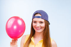 Happy teenage girl with red balloon. Royalty Free Stock Photo