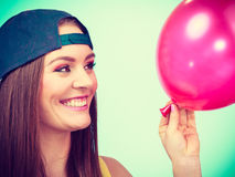 Happy teenage girl with red balloon. Royalty Free Stock Photos