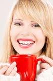Happy teenage girl with red mug Stock Images