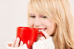 Happy teenage girl with red mug Royalty Free Stock Image
