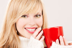 Happy teenage girl with red mug Stock Photography