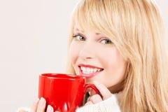 Happy teenage girl with red mug Royalty Free Stock Photo