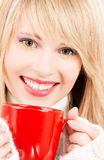 Happy teenage girl with red mug Stock Photo