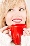 Happy teenage girl with red mug Royalty Free Stock Photos