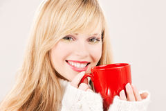 Happy teenage girl with red mug Royalty Free Stock Images