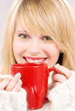Happy teenage girl with red mug Royalty Free Stock Photography