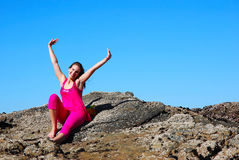 Happy teenage girl on rocks Royalty Free Stock Photos