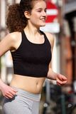 Happy teenage girl running outdoors Stock Image