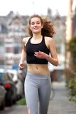Happy teenage girl running outside Stock Photo