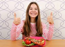 Teenage girl with sandwiches and thumbs up royalty free stock images