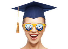Happy teenage girl in shades and mortarboard hat. Graduation, education, school and people concept - happy screaming teenage girl in shades and blue mortarboard Stock Images