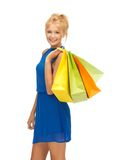 Happy teenage girl with shopping bags Royalty Free Stock Images