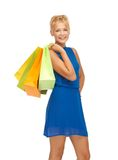 Happy teenage girl with shopping bags Royalty Free Stock Image