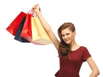 Happy teenage girl with shopping bags Royalty Free Stock Photography