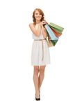 Happy teenage girl with shopping bags Stock Image