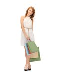 Happy teenage girl with shopping bags Stock Photo