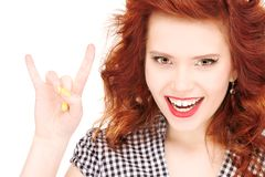 Happy teenage girl showing devil horns gesture stock photos