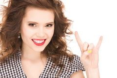 Happy teenage girl showing devil horns gesture Royalty Free Stock Photo