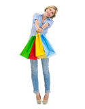 Happy teenage girl showing shopping bags Royalty Free Stock Photo