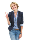 Happy teenage girl showing victory gesture Royalty Free Stock Image