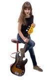 Happy teenage girl sitting on bar stool Stock Photo