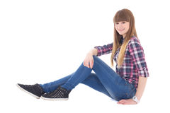 Happy teenage girl sitting isolated on white Royalty Free Stock Photography