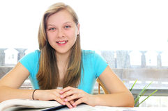 Happy teenage girl studying Royalty Free Stock Photos