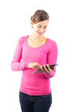 Happy teenage girl with tablet computer Stock Images