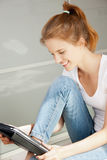 Happy teenage girl with tablet pc computer Stock Image