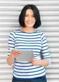 Happy teenage girl with tablet pc computer Royalty Free Stock Images