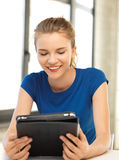 Happy teenage girl with tablet pc computer Stock Photo