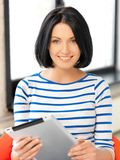 Happy teenage girl with tablet pc computer Royalty Free Stock Photography