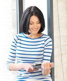Happy teenage girl with tablet pc computer Royalty Free Stock Photos