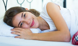 Happy teenage girl waking up and smiling indoors Stock Photos