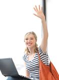 Happy teenage girl waving a greeting Royalty Free Stock Image