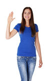 Happy teenage girl waving a greeting Royalty Free Stock Photo